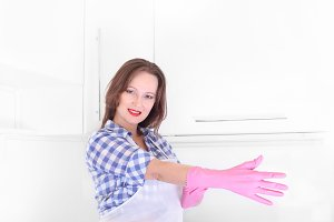 woman homemaker with rubber gloves