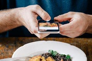 Man takes pictures vegetarian food