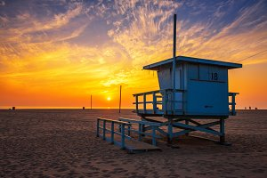 Sunset over Santa Monica beach with lifeguard observation tower