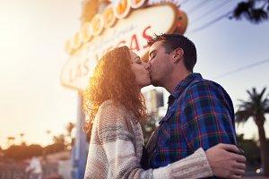 romantic couple kissing in vegas