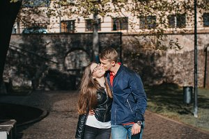 Young couple kissing in the street.