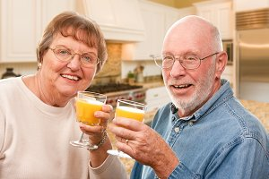 Senior Couple In House Juice