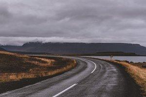Lonely Road through Autumn Landscape