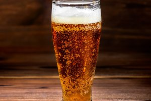 dark glass beer on rustic table wood