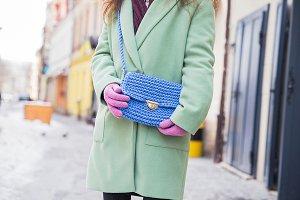 Stylish woman in mint winter coat