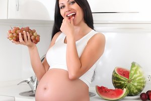 pregnant woman on kitchen
