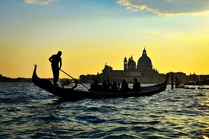 Venice sunset with gondola in Italy
