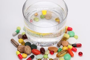 vitamins,tablets and pills and glass