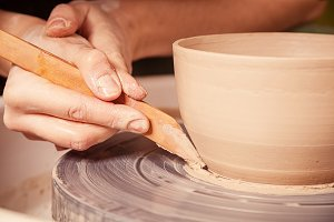Woman potter  sculpts