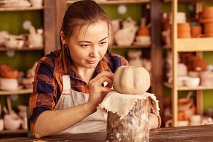 Artist painting pumpkin
