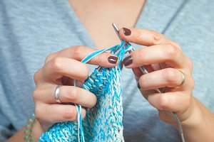 Woman knits  gray cardigan