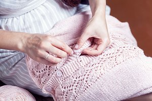 Woman sews a button