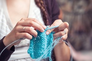 A young woman knits