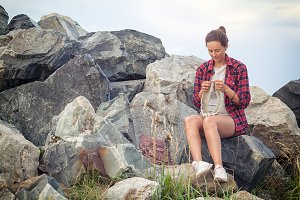 Woman  knits  near the sea