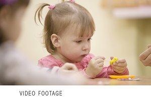 Little girl in the nursery.
