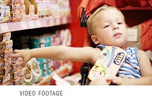 Little boy in the shop.