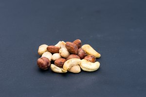 A variety of nuts on a black backgro