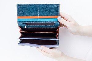 An empty wallet in hand
