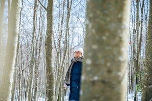 Senior woman in the snow
