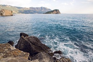 large boulders lie on the beach in Montenegro