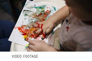Boy painting.