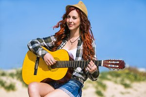 Pretty woman playing a guitar