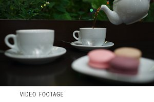 Tea with macaroons in cafe.