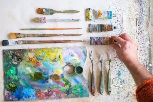 palette of an artist with brushes.