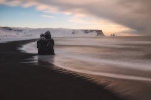 Reynisfjara snowed beach in winter,