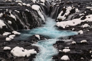 Blue Bruarfoss waterfall in winter i