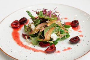 Salad with soft cheese and cherry