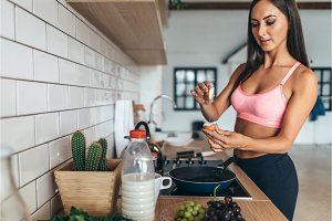Fitness woman prepare breakfast. Healthy homemade oatmeal with vegetables