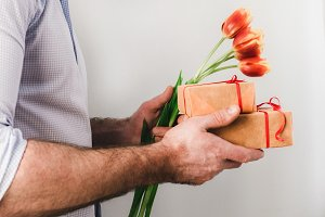 Man with gifts and flowers
