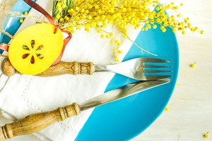 Easter table setting with mimosa