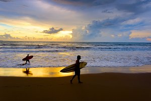surfers with surfboard walking