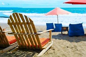 Chairs, sacks  umbrellas ocean beach