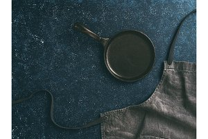denim cotton apron on dark background, copy space