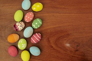 Colorful Easter eggs on wooden