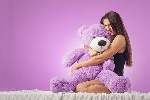 Woman with a huge teddy bear