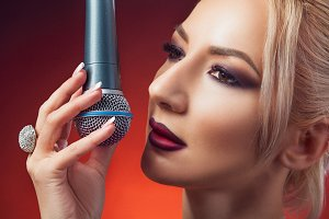 Beautiful woman with microphone.