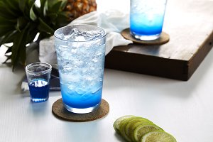 Ice Blue Lime soda on wooden table