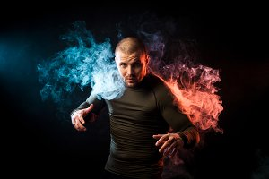 Athlete posing against smoke