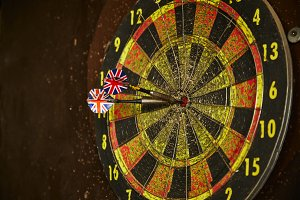 old dart board with dart arrow