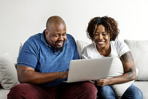 Black couple using digital device