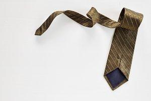 Necktie on white wooden background ,