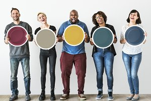 Diverse people holding blank board