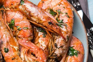 Grilled shrimps on pastel background