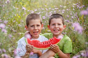Children eating watermelon