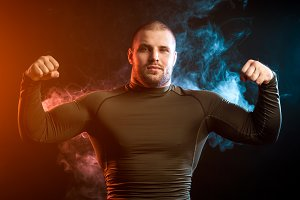 Sport man against vape smoke