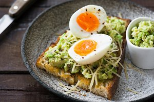 Toast with mashed avocado and egg